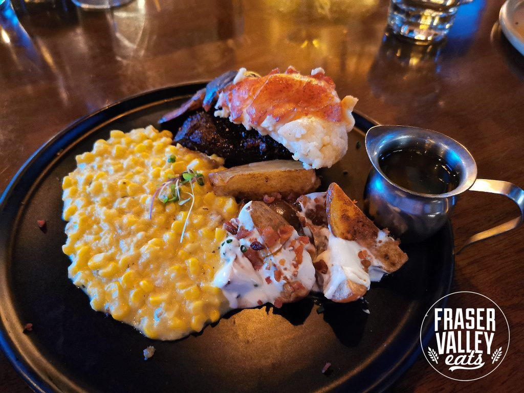 Wagyu flat iron 8 oz steak with Lobster Mashed Potatoes and Bacon Cream Corn