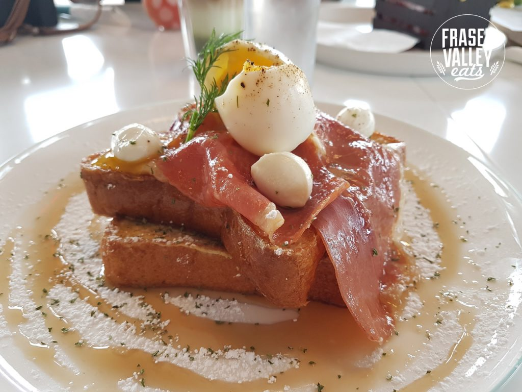 Fighter French Toast with Serrano ham, maple syrup and dusted with pwdered sugar