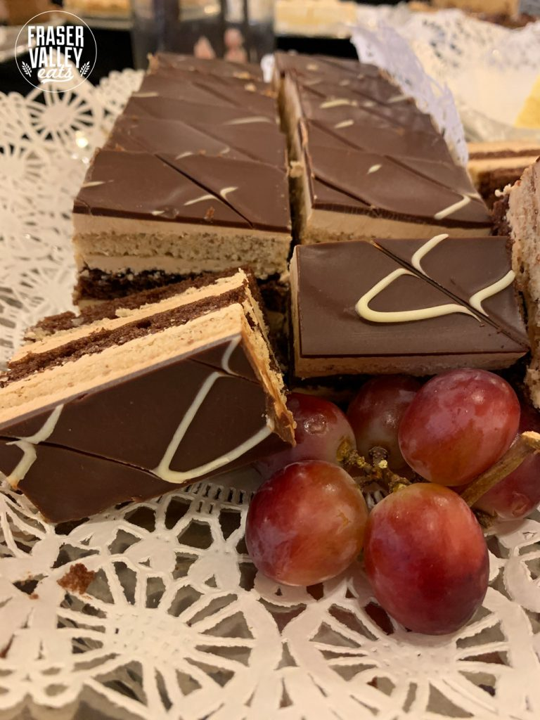 cakes with grapes in front