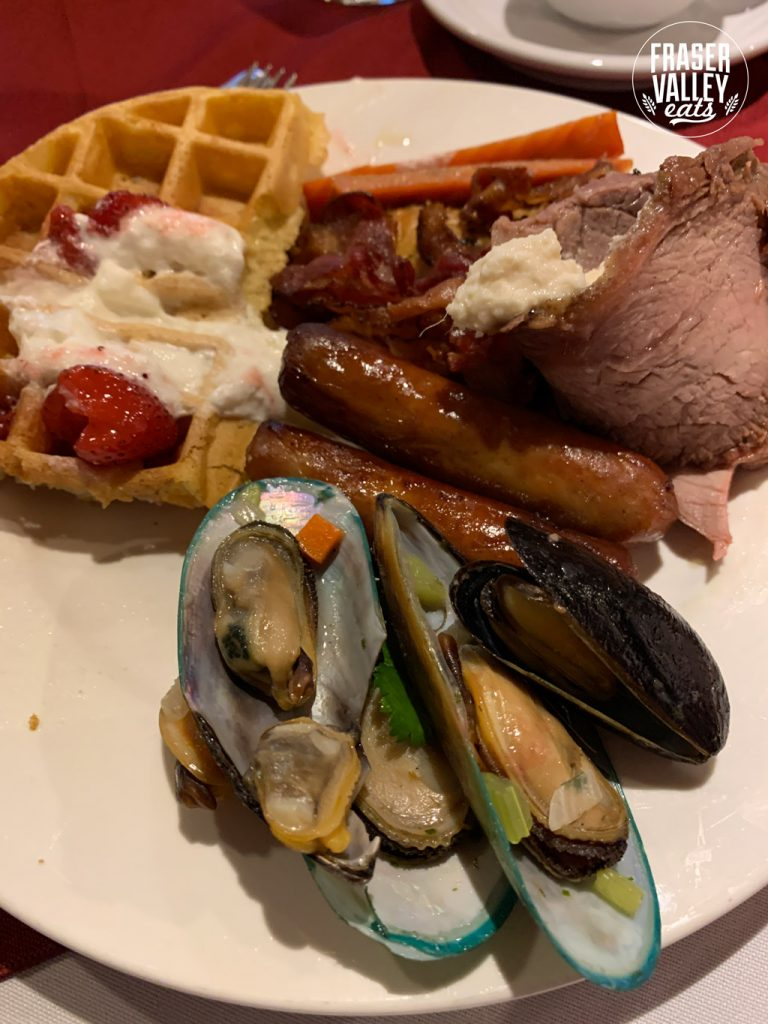 Waffles with strawberries and cream, sausage, bacon, smoked salmon, roast beef and shellfish