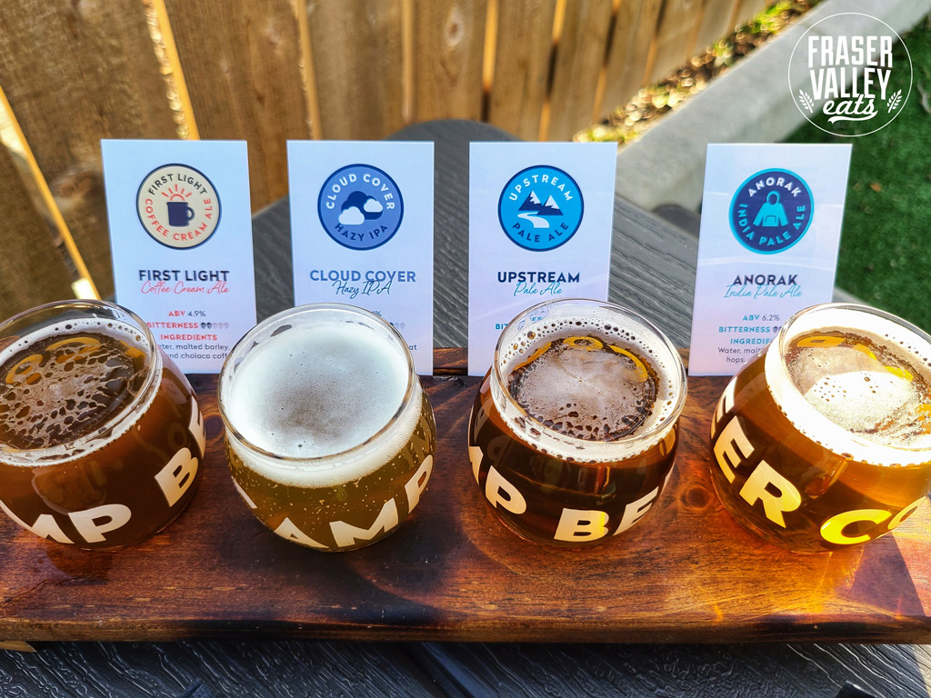 A flight of four beers including three pale ales and a coffee cream ale from Camp Beer Co.