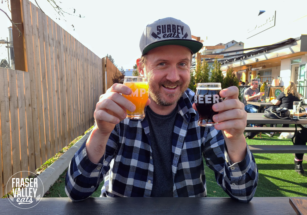 Craig double-fists a couple beers from Camp Beer Co while wearing a Surrey Eats hat